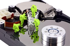 anti-virus technicians working on infected hard disk drive - concept diagram